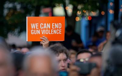 A sign is displayed during a vigil in Dayton, Ohio, Aug. 4, 2019. (CNS photo by Bryan Woolston/Reuters)