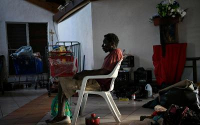 A man sits inside a damaged church serving as a shelter in Marsh Harbour, Bahamas, Sept. 8, 2019, in the aftermath of Hurricane Dorian.