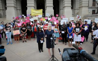 """Staci Fox, chief executive and president of Planned Parenthood Southeast, speaks in protest of Georgia's """"heartbeat"""" bill at the state Capitol in Atlanta May 7, 2019."""