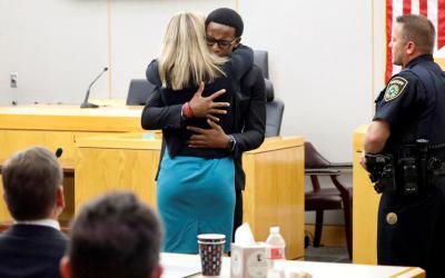 Brandt Jean, the younger brother of murder victim Botham Jean, hugs former Dallas police officer Amber Guyger.