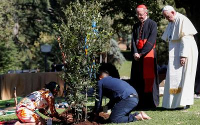 Pope Francis and Brazilian Cardinal Claudio Hummes, relator general of the Synod of Bishops on the Amazon, watch as members of an indigenous community plant a tree during a celebration marking the feast of St. Francis in the Vatican Gardens Oct. 4, 2019. (CNS photo by Yara Nardi/Reuters)