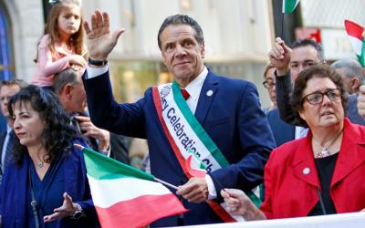 New York Gov. Andrew Cuomo waves as he marches in the Columbus Day Parade in New York City Oct. 14, 2019.