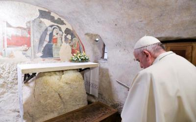 Pope Francis prays during a visit to the Nativity scene of Greccio, Italy, Dec. 1, 2019. (CNS photo by Vatican Media)
