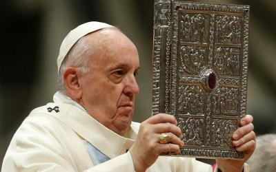 Pope Francis holds the Book of the Gospels as he celebrates Mass on the feast of Mary, Mother of God, in St. Peter's Basilica at the Vatican Jan. 1, 2020.