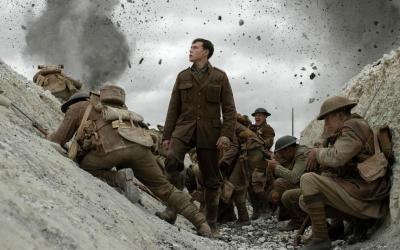 """George MacKay, center, stars in a scene from the movie """"1917."""""""