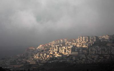 Clouds frame a section of the Israeli settlement of Beitar Illit in the Israeli-occupied West Bank Jan. 29, 2020.