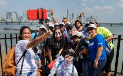 World Youth Day pilgrims from Honduras and Costa Rica take selfies with the skyline of Panama City in the background on Jan. 20, 2019.