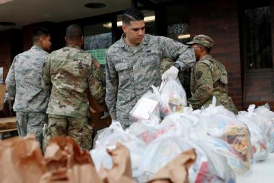 National Guard troops set up food donations in New Rochelle, N.Y., March 12, 2020.