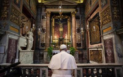 Pope Francis prays in front of a crucifix at the Church of St. Marcellus in Rome March 15, 2020.