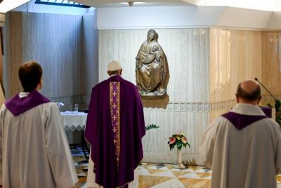 Pope Francis celebrates Mass March 16, 2020, in the chapel of his Vatican residence, the Domus Sanctae Marthae.