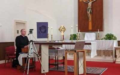 Father Ken Gill, pastor of Our Lady Star of the Sea Parish in Solomons, Md., livestreams noontime prayers March 19, 2020.