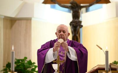 Pope Francis celebrates Mass in the chapel of his Vatican residence, the Domus Sanctae Marthae, March 26, 2020.