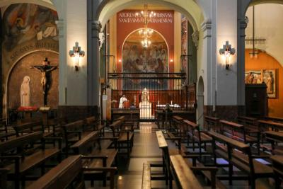 A priest celebrates Mass inside a chapel of a nearly empty church amid the coronavirus pandemic March 25, 2020, in Barcelona, Spain.