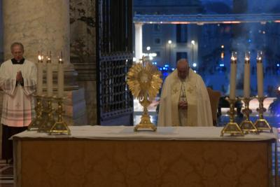 Pope Francis leads Benediction during a prayer service in the portico of St. Peter's Basilica at the Vatican March 27, 2020.