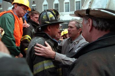 President George W. Bush embraces a firefighter at the site of the World Trade Center in New York City Sept. 14, 2001.