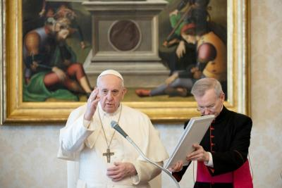 Pope Francis gives a blessing during his weekly general audience April 29, 2020, in the papal library in the Apostolic Palace.
