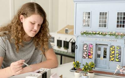 Ella Doyle, an eighth grader at St. Joseph's Catholic School in Minneapolis, works on a miniature stove and kitchen wall set May 12, 2020.