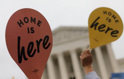 DACA demonstrators hold signs outside the U.S. Supreme Court in Washington Nov. 12, 2019.