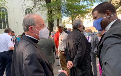Baltimore Archbishop William E. Lori and the Rev. Eugene Sutton, Episcopal Bishop of Maryland, talk before an interfaith prayer vigil in Baltimore June 3, 2020, to pray for justice and peace.
