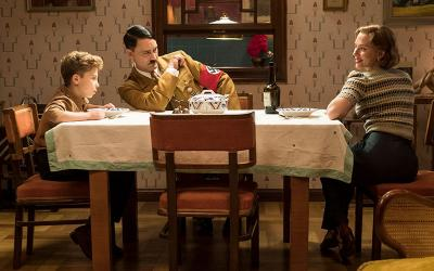 "Roman Griffin Davis, Taika Waititi and Scarlet Johansson are seen in the movie ""Jojo Rabbit."""