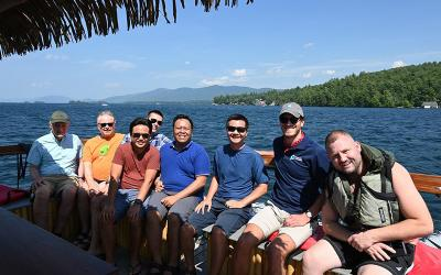 A group of priests and seminarians in New York pose for a photo on Lake George with Jimmy MacDonald, right, whom they saved from a capsized kayak Aug. 11, 2020.