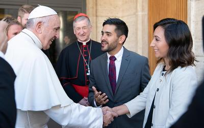 Pope Francis greets synod observer Yadira Vieyra of Chicago after a session of the Synod of Bishops on young people, the faith and vocational discernment, in 2018 at the Vatican. Looking on is Cardinal Blase J. Cupich of Chicago.