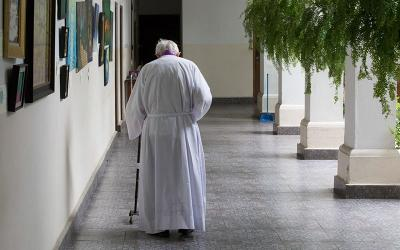 An elderly priest is pictured in a file photo walking to his residence at Our Lady of Carmen Church in Panama City.