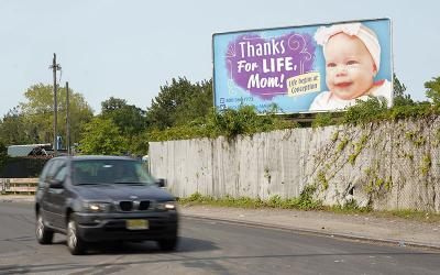 A car drives past a pro-life billboard in the Staten Island borough of New York Sept. 14, 2020.
