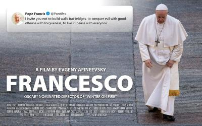 """A poster for the new film, """"Francesco,"""" by documentary filmmaker Evgeny Afineevsky, shows Pope Francis walking in St. Peter's Square at the Vatican."""