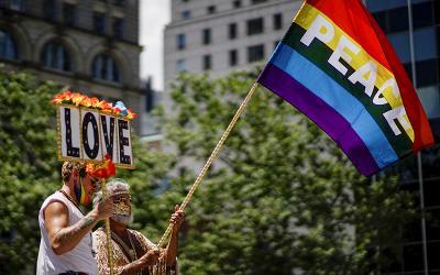 LGBTQ demonstrators in New York City hold a pride flag June 28, 2020.