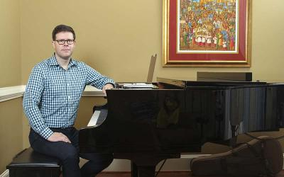 Tony Alonso, assistant professor of theology and culture and director of Catholic Studies at Emory University in Atlanta, sits at the piano in his Decatur, Ga., home Oct. 19, 2020.