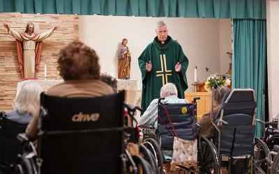 Father Martin Bancroft Jr. celebrates Mass marking World Day of the Sick at Our Lady of Consolation Nursing and Rehabilitative Care Center in West Islip, N.Y., Feb. 11, 2020.