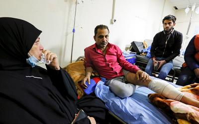 A man who was wounded during a twin suicide bombing attack in a central Baghdad market receives treatment at a hospital in Baghdad Jan. 21, 2021.