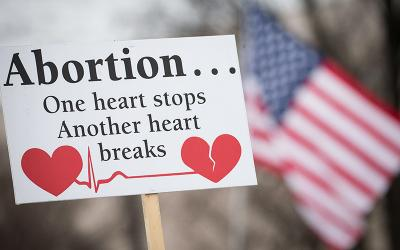 A pro-life sign is displayed during the 2019 annual March for Life rally in Washington.