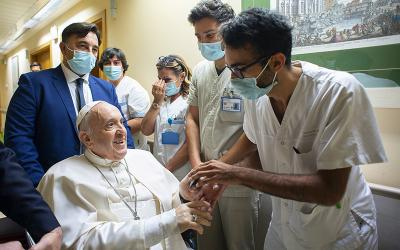 Pope Francis gives a rosary to a member of the medical staff at Gemelli hospital in Rome July 11, 2021, as he recovers following scheduled colon surgery.