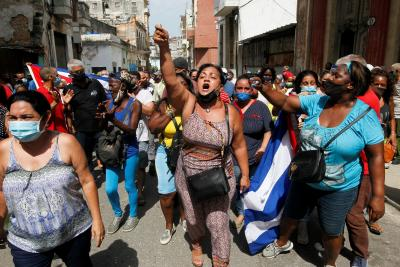 Government supporters react during protests in Havana July 11, 2021