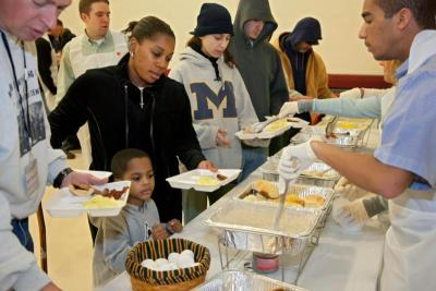 Volunteers serve breakfast to the needy at a shelter in Mount Clemens, Mich.