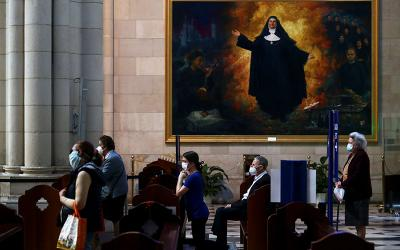 People keep social distancing as they attend Mass for first time in two months at a church in Madrid May 18, 2020, as parts of the country relax restrictions during the COVID-19 pandemic.
