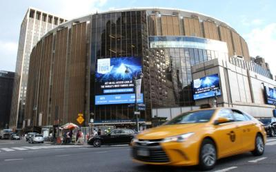 A taxi drives past Madison Square Garden in New York City.