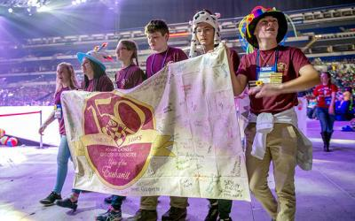 <p>Anna Crawford (far left) from the cluster of St. Agnes, Avon/St. Rose, Lima/St. Paul of the Cross, Honeoye Falls, carries the Diocese of Rochester banner during the opening ceremony of the National Catholic Youth Conference in Indianapolis Nov. 16. (Courier photo by Jeff Witherow) </p>
