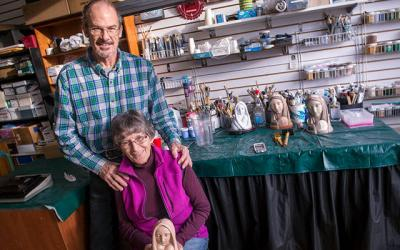 """<p>David and Mary Hoysic pose at their Phelps studio Dec. 13 with artwork created by the late Maryknoll Sister Marie Pierre Semler. Mary Hoysic is holding a sculpture titled """"God With Us.""""  </p>"""