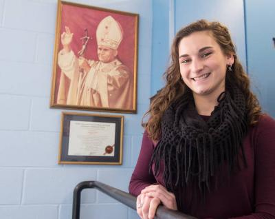 <p>Sarah Neubecker of Canandaigua, a senior at Our Lady of Mercy High School, puts her faith into action by taking part in service projects and mission trips. (Courier photo by John Haeger)  </p>