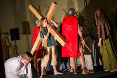 <p>Simon of Cyrene, played by Ayden Kemp, helps Jesus carry his cross during a March 9 Living Stations of the Cross at St. Mary Church in Corning. The performance was presented by youths from Blessed Trinity/St. Patrick parishes in Tioga County.  </p>