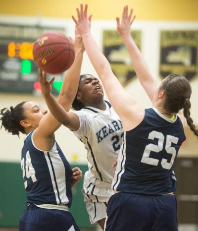 <p>Bishop Kearney's Saniaa Wilson (21) drives the lane for two as Mercy's Traiva Breedlove (24) and Katie Titus (25) defend in the fourth quarter of the Section 5 Class AA sectional championship game March 3.  </p>