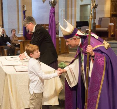 <p>Bishop Salvatore R. Matano shakes the hand of catechumen Collin Boyle during the Feb. 18 Rite of Election and Call to Continuing Conversion at Sacred Heart Cathedral in Rochester.  </p>
