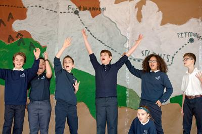 "Fifth-graders at St. Louis School in Pittsford rehearse Jan. 20 for their musical production, ""The Adventures of Lewis and Clark."""