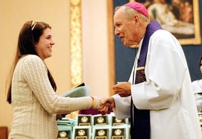 """Aryn Smith, a parishioner of Hornell's Our Lady of the Valley Parish, receives her Hands of Christ award from Bishop Matthew H. Clark March 28 at Greece's Our Mother of Sorrows Church. (<a href=""""http://catholiccourier.smugmug.com/Other/2011-Hands-of-Christ-in-Greece/16503088_zpNYR#1242195379_43n8R"""" target=""""_blank"""">Click  here</a> to view more photos from this event and/or buy prints.)"""