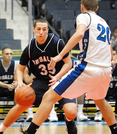 DeSales junior forward Tom Kanaley drives past Whitesville's Marcus Schoen during the Section Five Class D2 championship game March 3 at the Blue Cross Arena.