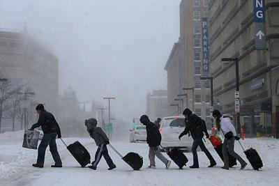 Travelers leave a subway station during a nor'easter snow storm in Boston Jan. 3. The snow and subzero temperatures in some parts of the U.S. have caused churches and charitable agencies to adapt and reach out to help