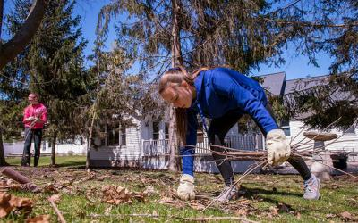 <p>Grace Kitterman (left) and Alyson Postle from St. Patrick Church in Victor perform yard work in the community April 22 as part of the church's monthly Youth Service Sunday.  (Courier photo by Jeff Witherow) </p>